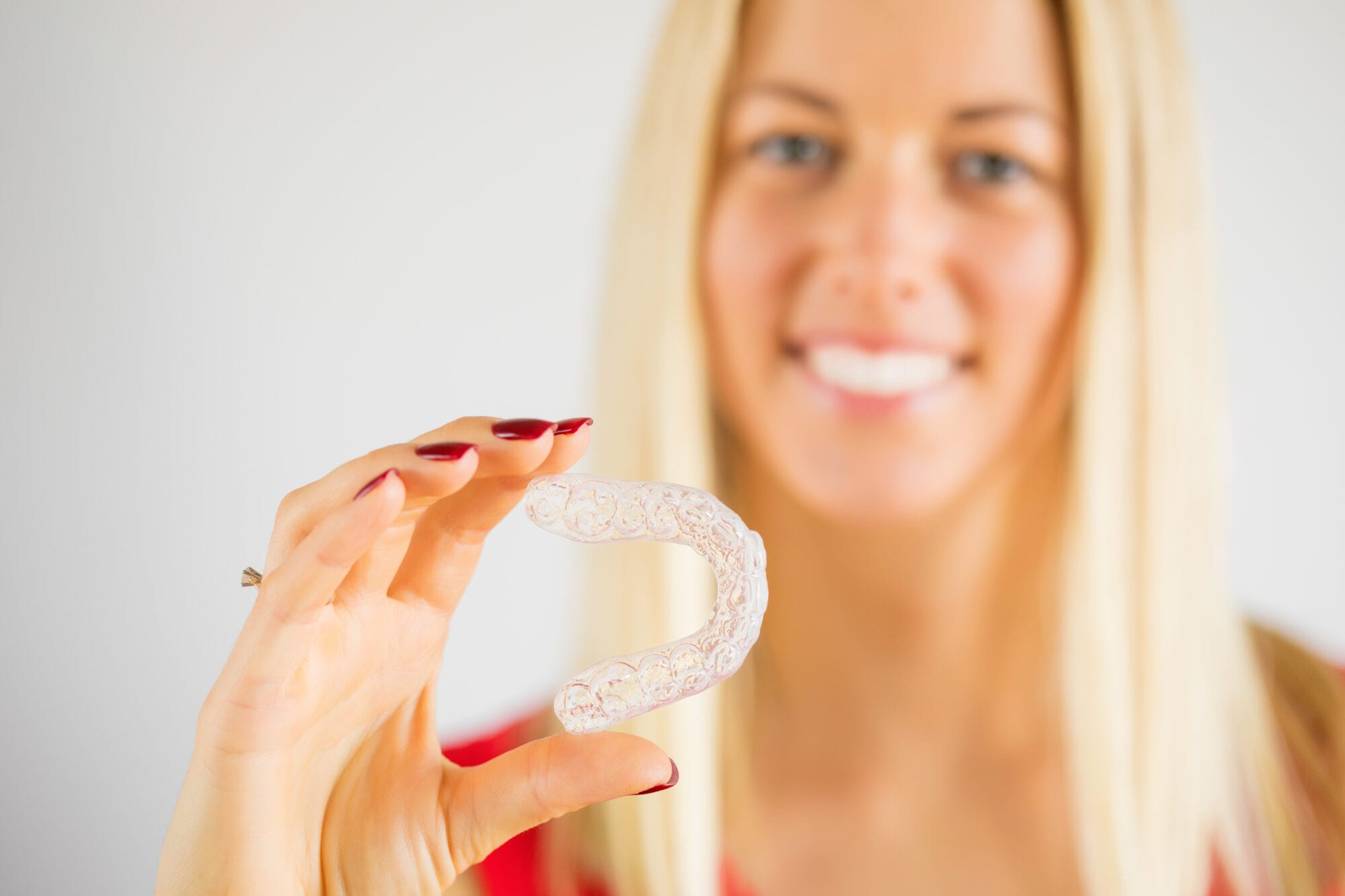 Woman holding teeth whitening tray